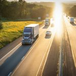 highway-and-semi-truck-18-wheeler-hauling-freight-at-sunset_t20_NxBKol